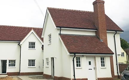essex house with tudor tiles photo1