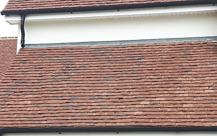 essex house with tudor roof tiles photo2